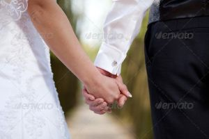Bride and Groom Holding Each Other Hand by Ondrejvasak