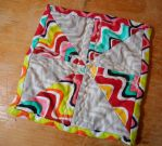 Pinwheel ZigZag hot pad in grey and colors by ChaosFay