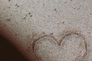 Writing amateur poems in the sand by LovieLovetree