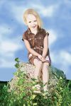 girl sitting on the stone by Lilitka