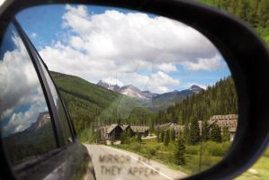Colorado Mountains in my rear view mirror by EyeInFocus
