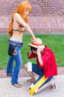 Nami Hits Luffy: One Piece Time Skip Cosplay by firecloak