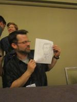 Chris Ode holding Quick Drawing I by Poorartman