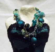 teal green and silver charm bracelet by ACrowsCollection