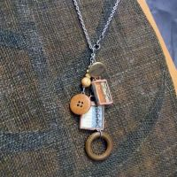 Buttons Lace and Measureing Tape Charm Necklace by colormecrazi