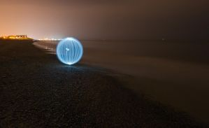 Ball of light by the shore. by chivt800