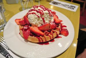Waffle with strawberries and iced cream by Shinseigo-Takashi