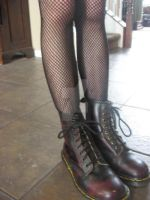 My boots + Fishnets by alonebutloved