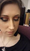 gold, black, and red eyeshadow by janielle623