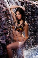 Girl in a waterfall by JJImages