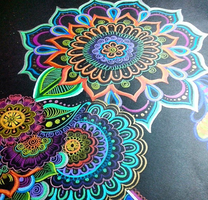 Flower doodles with different colours in black pap by aoiblue02