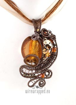 Amber yellow steampunk pendant by ukapala