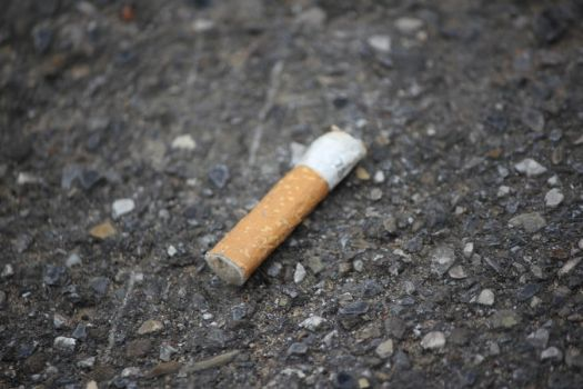 cigarette on the floor by imugno